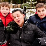 Father and sons having fun in the snow